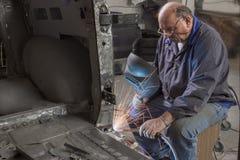 Portrait of an elderly mechanic Royalty Free Stock Photography