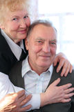 Portrait of elderly pair. Looking at camera stock image