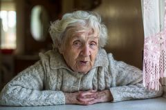 Portrait of elderly pensioner lady with an ironic look . royalty free stock photos