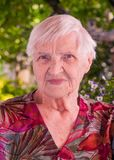 Portrait of an elderly woman smiling royalty free stock photos