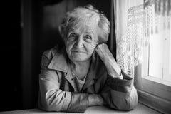 Portrait of an elderly sad woman, monochrome photo. Stock Photo