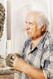 Portrait of elderly sculptor Stock Photo