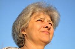 Portrait of an elderly woman Stock Images