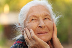 Portrait of the elderly woman. A photo on outdoors Royalty Free Stock Photos