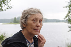 Portrait of elderly woman. At the lake side Stock Images