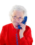 Portrait of elderly woman. Is in red with an dark blue telephone Stock Images