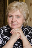 Portrait of elderly woman in a black and white blouse royalty free stock photography