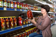 Portrait of an elderly woman buying a tomatoes royalty free stock images