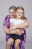 Portrait of an elderly woman covering her granddaughter Stock Photos