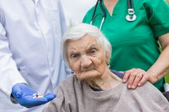 Portrait of elderly woman with dementia disease stock image