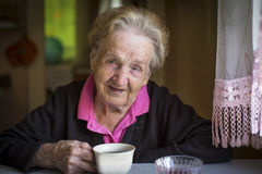 Portrait of elderly woman drinking tea. Happy. Stock Images