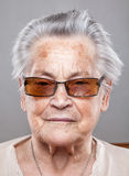Portrait of an elderly woman with glasses Stock Image