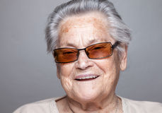 Portrait of an elderly woman with glasses Stock Photos
