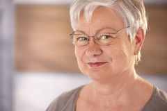 Portrait of elderly woman with glasses Stock Image