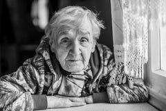 Portrait of an elderly woman. Grandma royalty free stock image