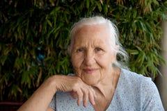 Portrait of elderly woman. Portrait of happy elderly woman outside stock photography