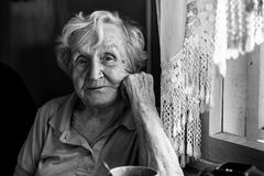 Portrait of an elderly woman in her home. Royalty Free Stock Image