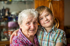 Portrait of an elderly woman with her little grandson. Love. Royalty Free Stock Photos