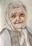 Portrait of an elderly woman in a kerchief with a smile on her face. Pencil graphics royalty free illustration