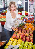 Portrait of elderly woman offering fruits Royalty Free Stock Photo