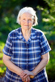 Portrait of an elderly woman outdoors Stock Image
