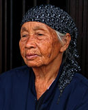 PORTRAIT OF ELDERLY WOMAN IN PADANG CITY INDONESIA. A portrait of an elderly woman in a wet market in the city of Padang in West Sumatra royalty free stock photography