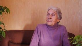 Portrait of elderly woman. stock footage