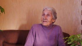 Portrait of elderly woman. stock video