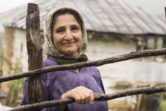 Portrait of an Elderly Woman in Rainy Day Royalty Free Stock Images