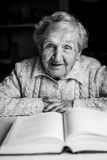 Portrait of elderly woman reading a book. Royalty Free Stock Images
