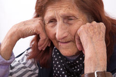 Portrait of an elderly woman with sad face expression Stock Photos