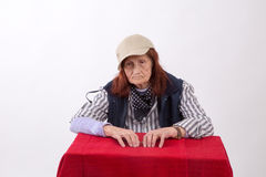 Portrait of an elderly woman with sad face expression Stock Images