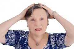 Portrait of elderly woman shocked. With her hands on face. Isolated white background stock images