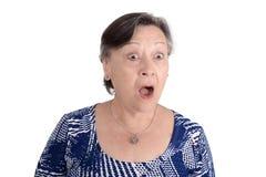 Portrait of elderly woman shocked. Isolated white background stock photography