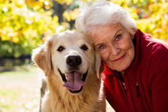 Portrait of elderly woman sitting with dog royalty free stock images