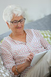 Portrait of elderly woman using tablet Royalty Free Stock Photos