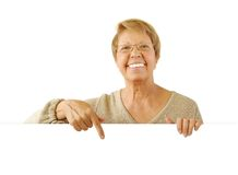 Portrait of elderly woman on the white stock photography