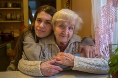 Elderly woman with her adult granddaughter. Stock Photos