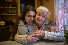 An elderly woman with her adult granddaughter. Stock Photography
