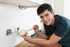 Portrait Of Electrician Installing Socket In New House royalty free stock photos