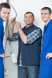 Portrait electrician with two apprentices Stock Photo