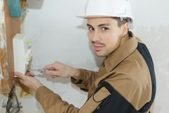 Portrait electrician using screwdriver Royalty Free Stock Photography