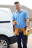 Portrait Of Electrician With Van Outside House Stock Image