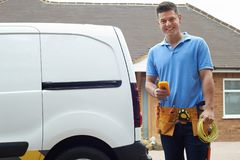 Portrait Of Electrician With Van Outside House royalty free stock photography