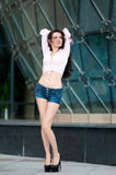 Portrait of elegance attractive woman in short jeans top Royalty Free Stock Images