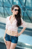 Portrait of elegance attractive woman in short jeans tro Royalty Free Stock Photography