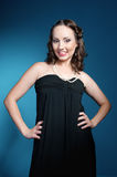 Portrait of an elegance young woman in a black dress Royalty Free Stock Photo