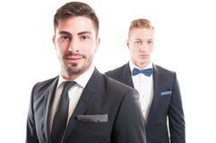 Portrait of elegant business men wearing necktie and bowtie. Portrait of handsome and elegant business men wearing necktie and bowtie Stock Photo