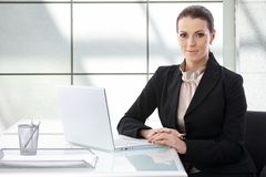 Portrait of elegant businesswoman with laptop Stock Image