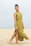 Portrait of an elegant fashion model walking at the beach Royalty Free Stock Photo